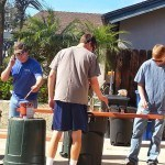 Boy Scouts helping to paint the benches.