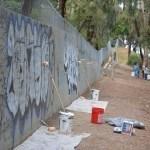 Graffiti covered retaining wall