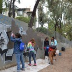 Girl Scout Troop working hard to paint over graffiti